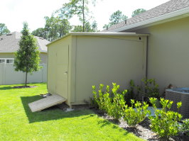 Lean to stucco shed
